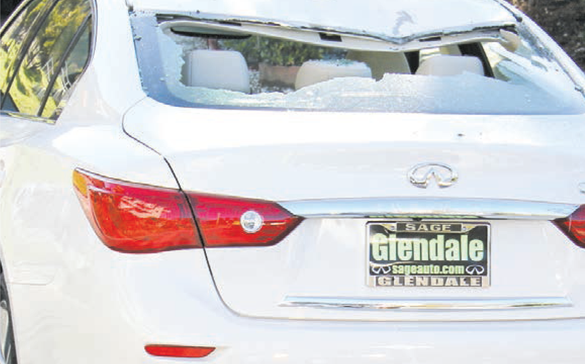 A brand new Infinity was hit with two rocks: one on the rear left fender and one on top, smashing the rear window.