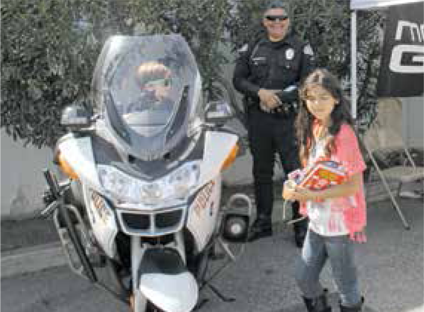 Kids loved sitting on a police motorcycle