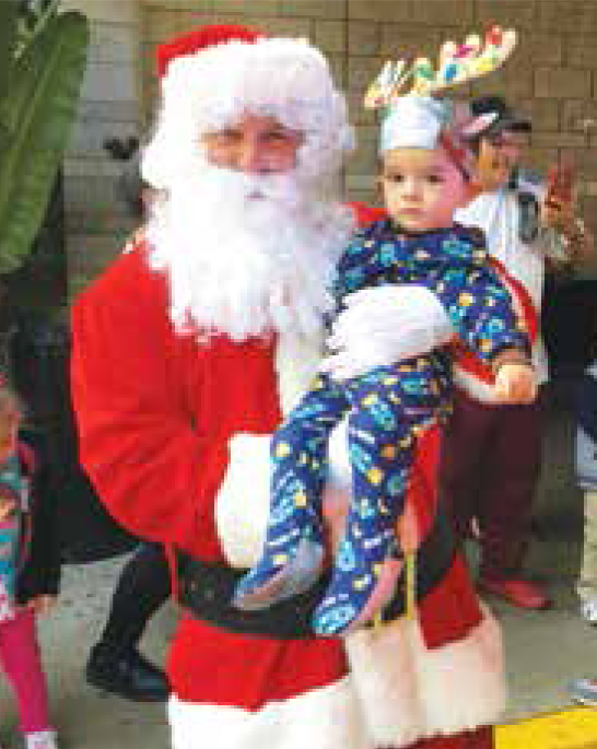 Santa and one of the smallest reindeers.